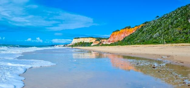 Arraial d'ajuda is a district of the brazilian municipality of porto seguro, on the coast of the state of bahia, cliff on pitinga beach