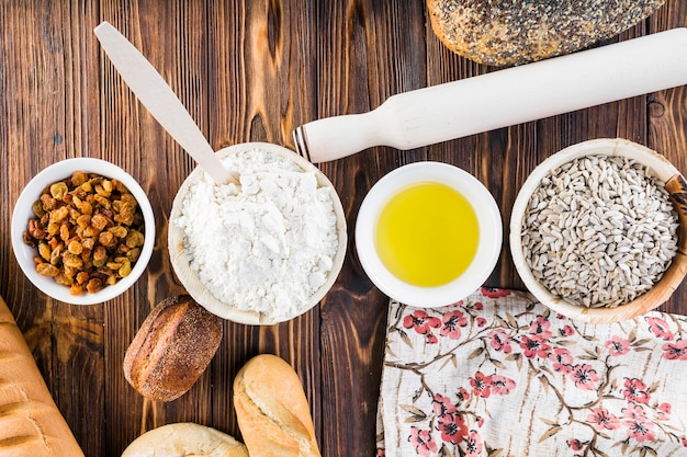 Arranged bread bakery ingredients with loaves on the table
