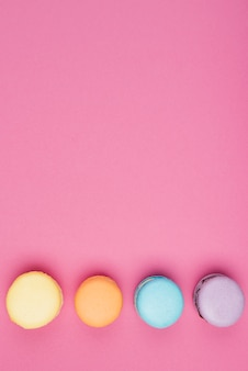 Arranged colorful macaroons with copy-space