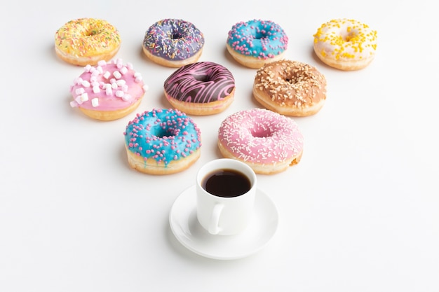Arranged donuts with coffee