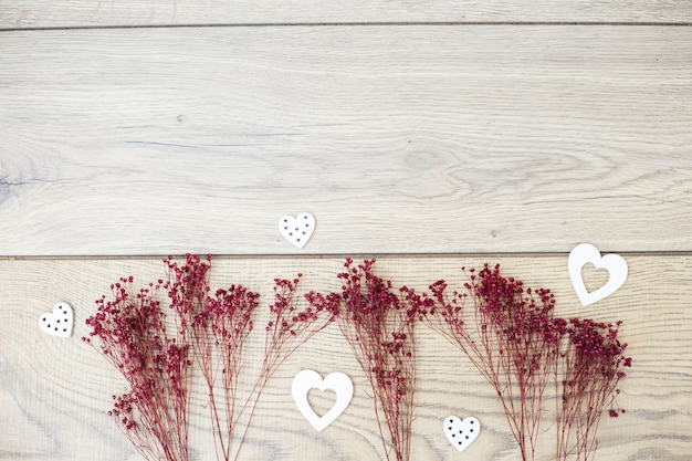 Arranged dry branches with romantic hearts