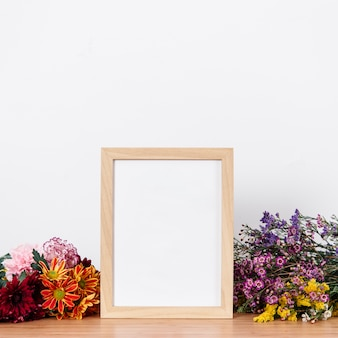 Arranged empty frame and flowers
