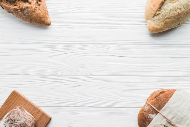 Arranged loaves on white table