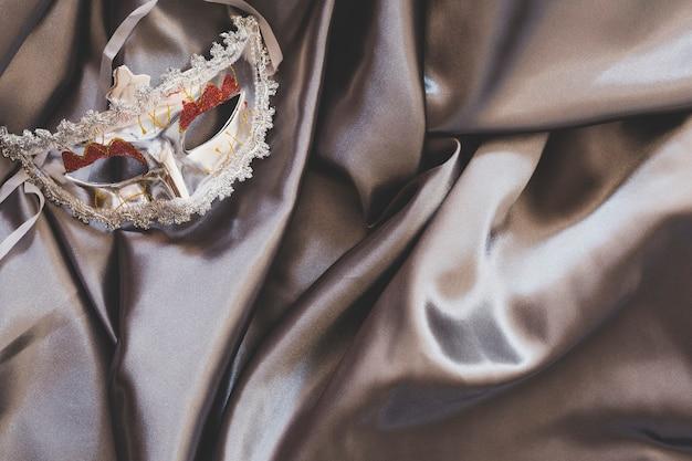Arranged mask on silver silk