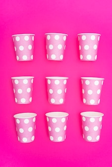 Arranged party paper cups in rows