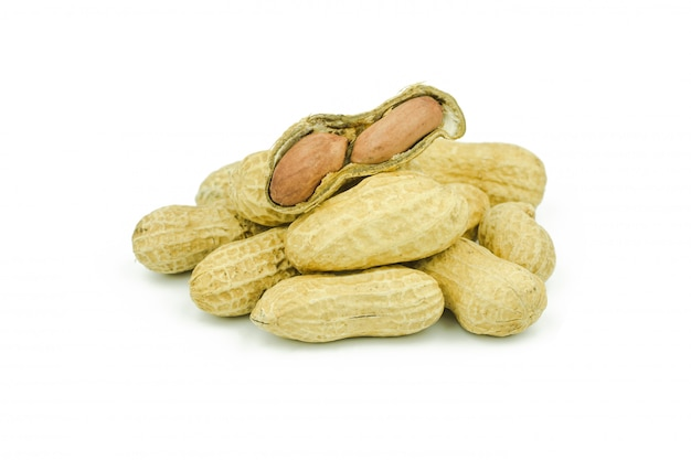 Arranged peanuts peeled and isolated on white background