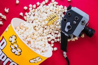 Arranged popcorn and camera