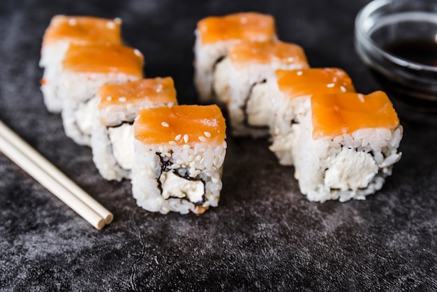 Arranged sushi rolls with sauce