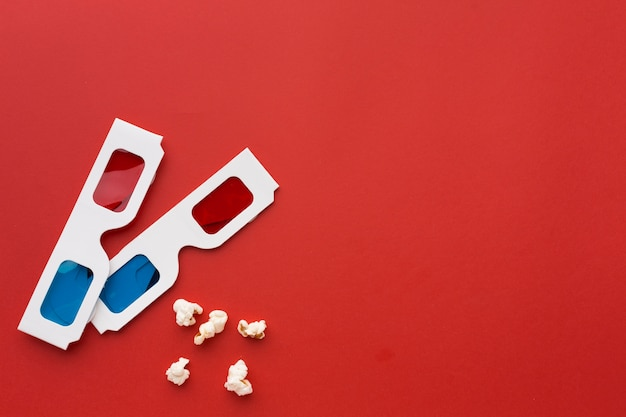 Arrangement of 3d glasses on red background with copy space