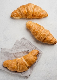 Arrangement of baked croissants and cloth