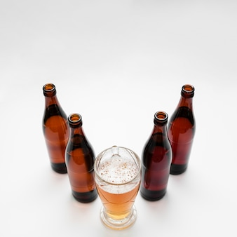 Arrangement of beer bottles with glass