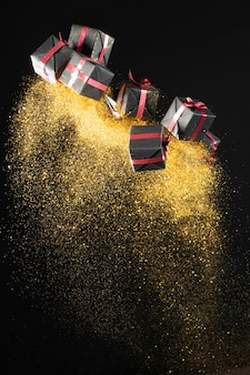 Arrangement of black friday gifts with golden glitter