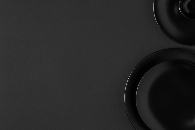 Arrangement of black plates with copy space