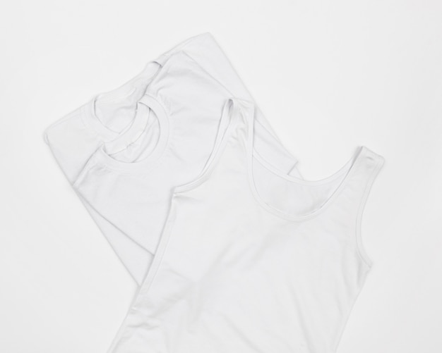 Arrangement of blank white t-shirts
