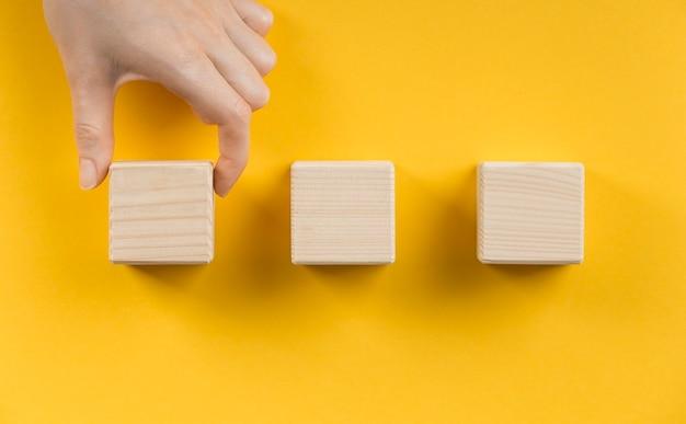 Arrangement of blank wooden cubes