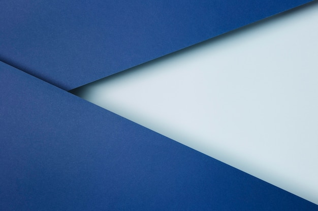 Arrangement of blue paper sheets background