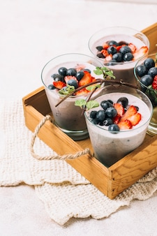Arrangement of blueberry and strawberry smoothies