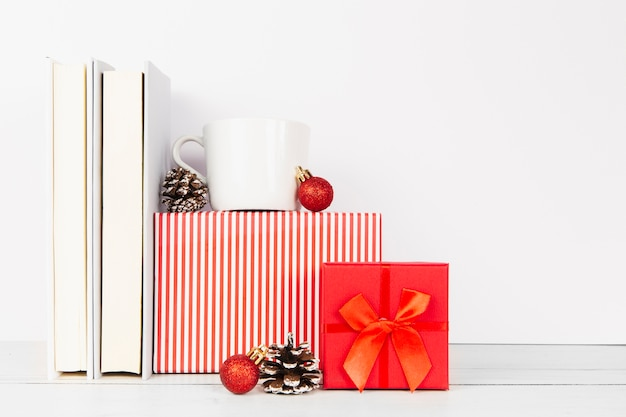 Arrangement of books and christmas gifts
