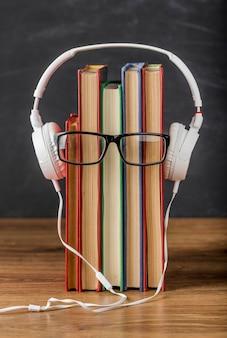 Arrangement of books with headphones