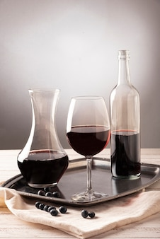 Arrangement of bottles and glass of wine