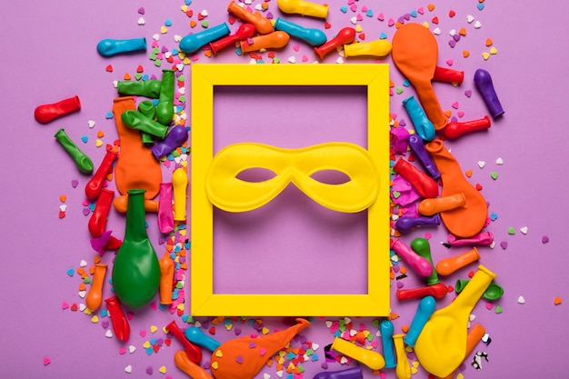 Arrangement of carnival objects with yellow frame