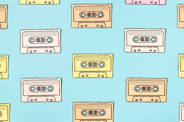 Arrangement of cassette tape on blue