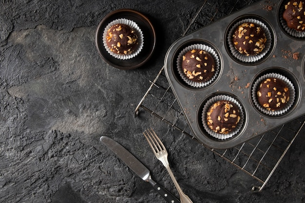 Arrangement of chocolate cupcakes with copy space