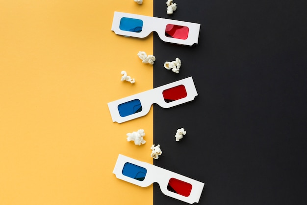 Arrangement of cinema objects on bicolor background