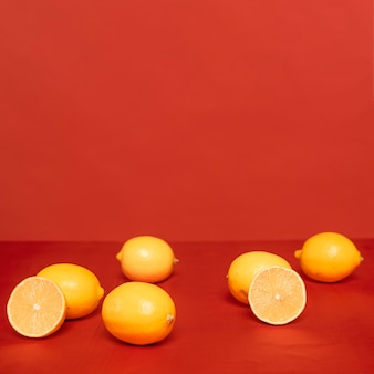 Arrangement of citruses on red