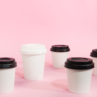Arrangement of coffee cups for individuality concept