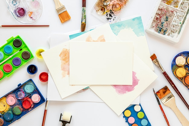 Arrangement of color palette in box and painted paper