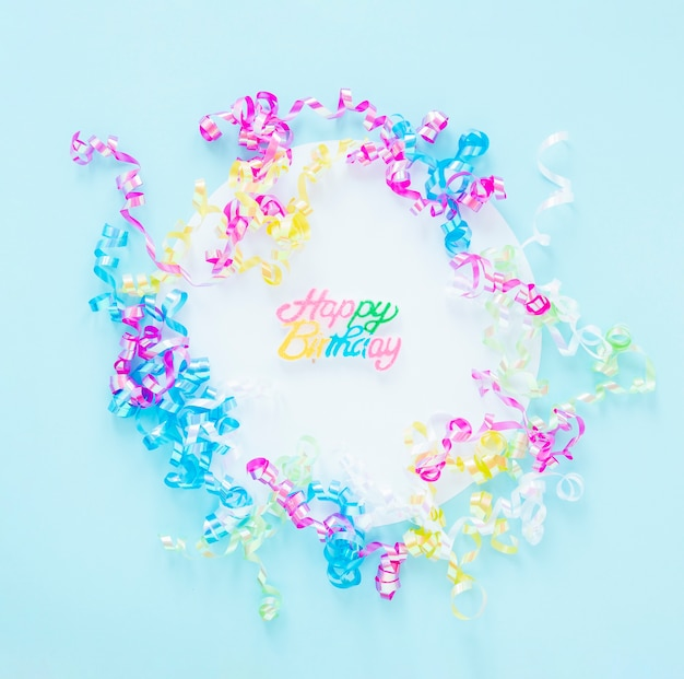 Arrangement of colorful confetti on blue background