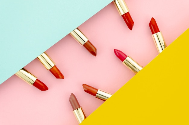 Arrangement of colorful lipsticks on colorful background
