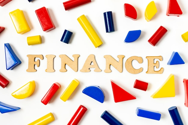 Arrangement of colourful geometrical shapes and finance text