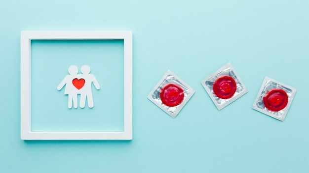 Arrangement of contraception concept with paper couple in frame