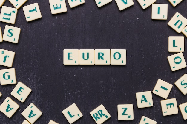 Arrangement of cubes with text euro on black background
