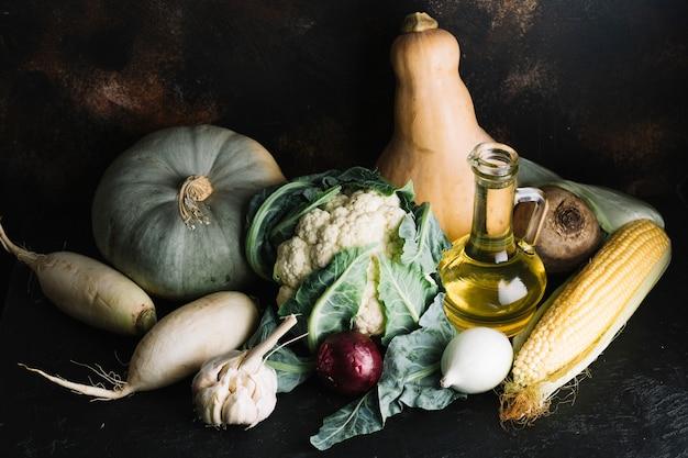 Arrangement of delicious autumn vegetables with olive oil