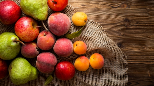 Arrangement of delicious autumnal fruits on cloth