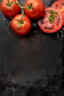 Arrangement of delicious fresh tomatoes with copy space