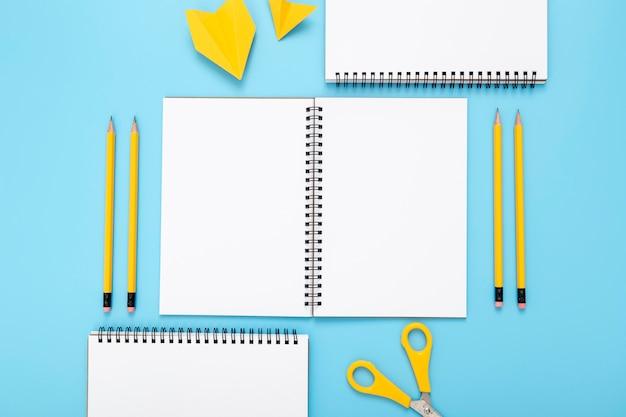 Arrangement of desk elements on blue background
