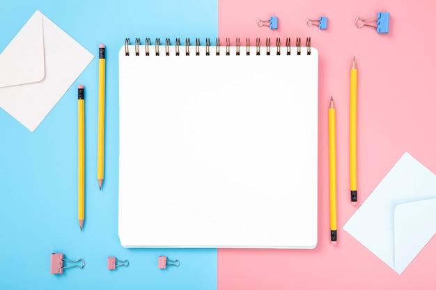 Arrangement of desk elements with empty notebook
