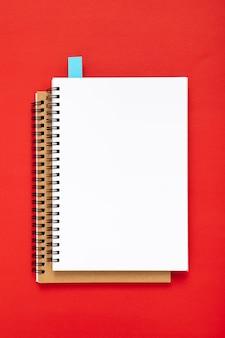Arrangement of desk elements with empty notebooks