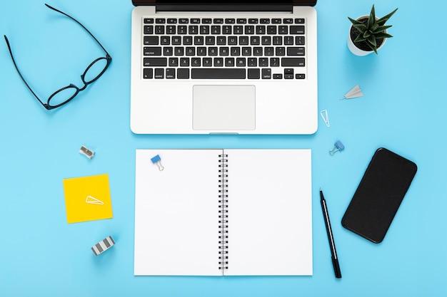 Arrangement of desk elements with opened ntoebook
