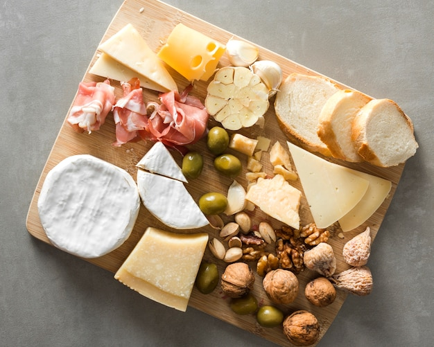 Arrangement of different delicacies on wooden board
