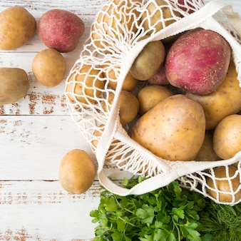 Arrangement of different raw potatoes in bag
