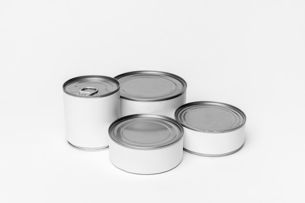 Arrangement of different tin cans with white labels