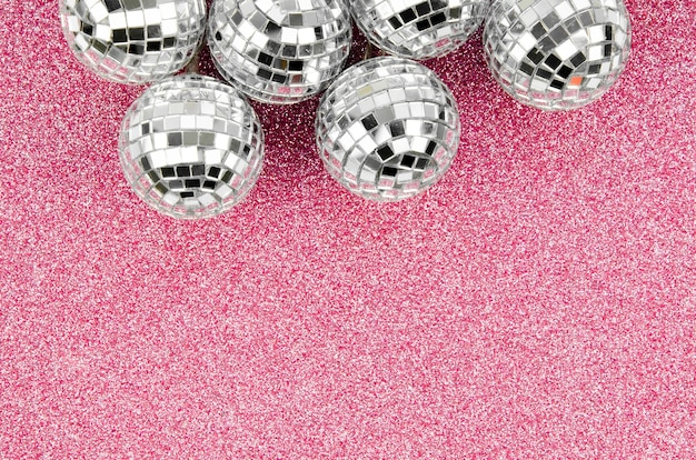 Arrangement of disco globes with copy space