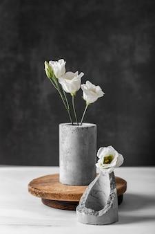 Arrangement of flowers in gray vase