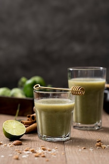 Arrangement of fresh green smoothies