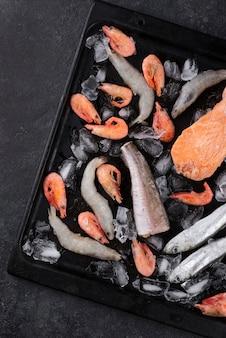 Arrangement of frozen sea food on the table